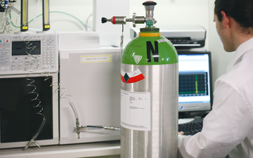 High-purity speciality gases being used in a laboratory for analysis