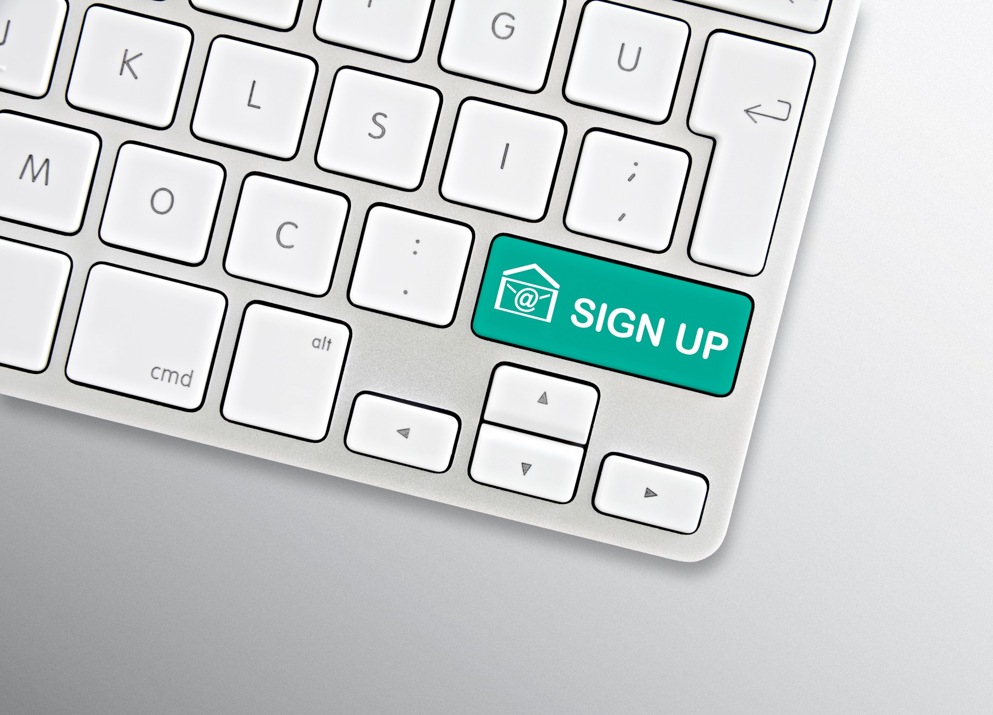 Sign up for emails icon shown on a key on a computer keyboard