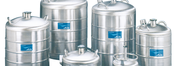 A collection of different sized dewars for storing cryogenic gases